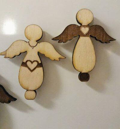 Google sökresultat för 'kylskåpsmagneter änglar i trä'